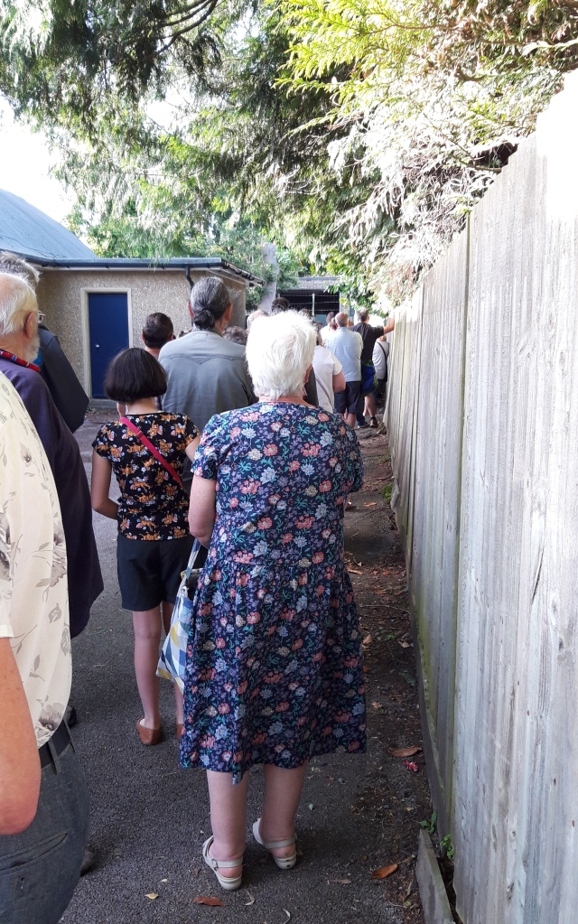 Queuing At A Jumble Sale